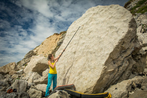 Emmie from After the Send using the Pongoose Climber 700 as a bouldering brushing stick on the boulder beach at Portland, UK.