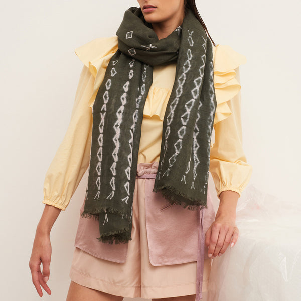 JANE CARR The Mojave Wrap in Khaki, linen tie-dye scarf - model