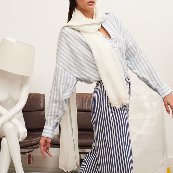 JANE CARR The Studio Wrap in White, cashmere linen scarf - model