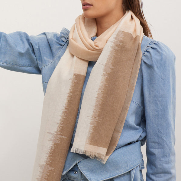 JANE CARR The Batik Wrap in Biscuit, striped cotton scarf - model