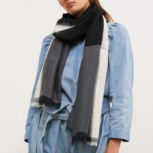 JANE CARR The Batik Wrap in Granite, striped cotton scarf - model