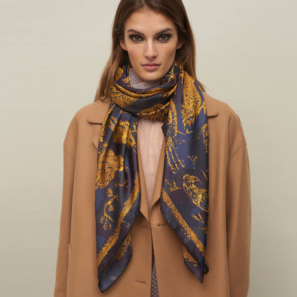 JANE CARR The Oiseaux Square in Amber, pure silk twill printed scarf – model