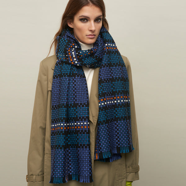 JANE CARR The Plaid Scarf in Denim, woven wool grid scarf – model