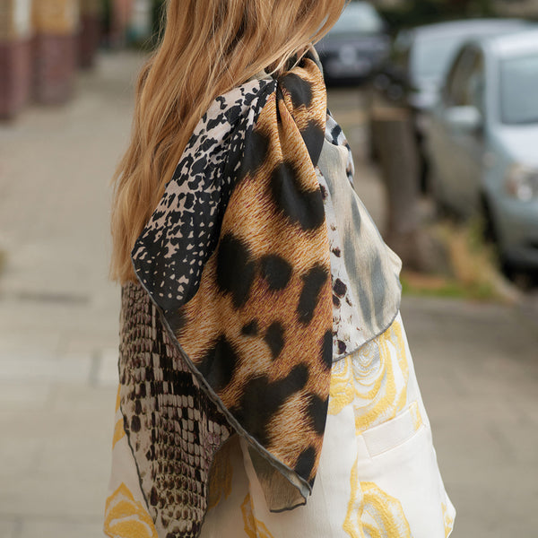 JANE CARR The Safari Square in Lion, modal and cashmere-blend printed scarf – model