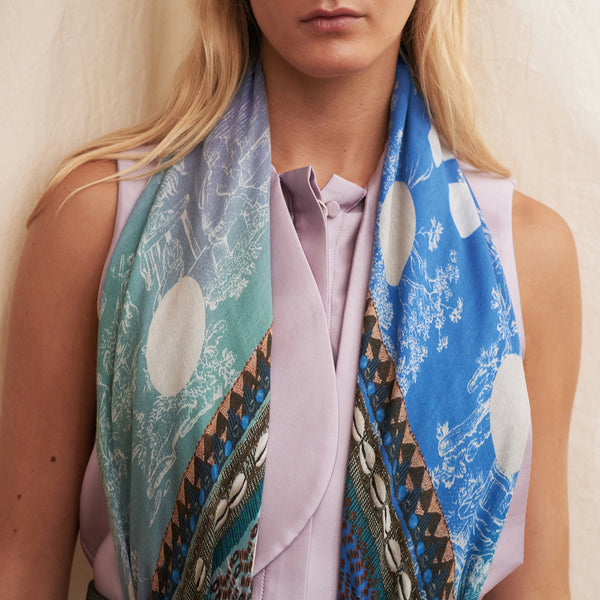 JANE CARR The Self Square in Boy, blue multicoloured printed modal and cashmere scarf – model