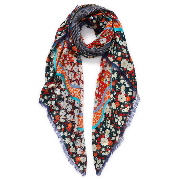 JANE CARR The Rickrack Square in Empress, blue and orange multicoloured printed modal and cashmere scarf – tied