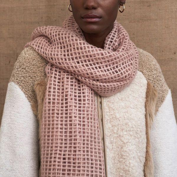 JANE CARR The Mesh Scarf in Rose, pink grid woven cashmere scarf – model