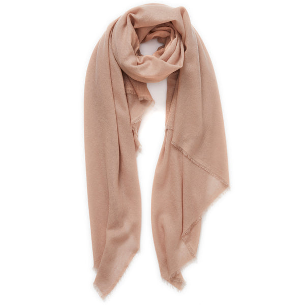 JANE CARR The Fray Wrap in Rose, pale pink woven pure cashmere scarf – tied