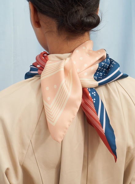 The Polka Petit Foulard in Bilberry, blue, red and pink printed silk twill scarf - model