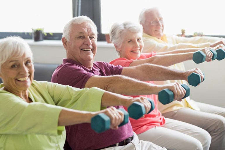 Stock image of a group of people lifting arm weights