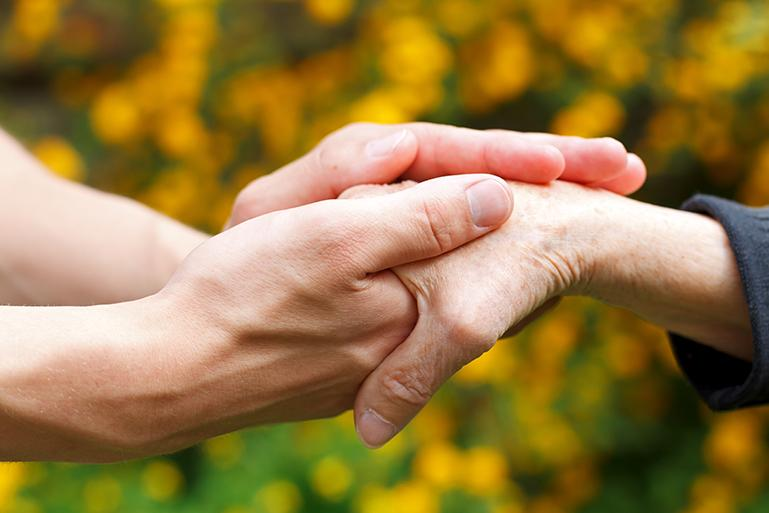 Helping an elderly woman with arthritis in her hand