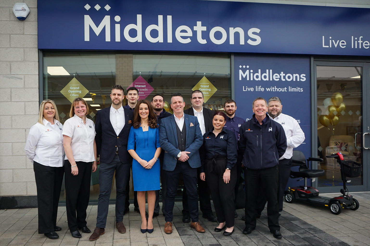 Middletons staff pose outside new Middletons Coventry showroom