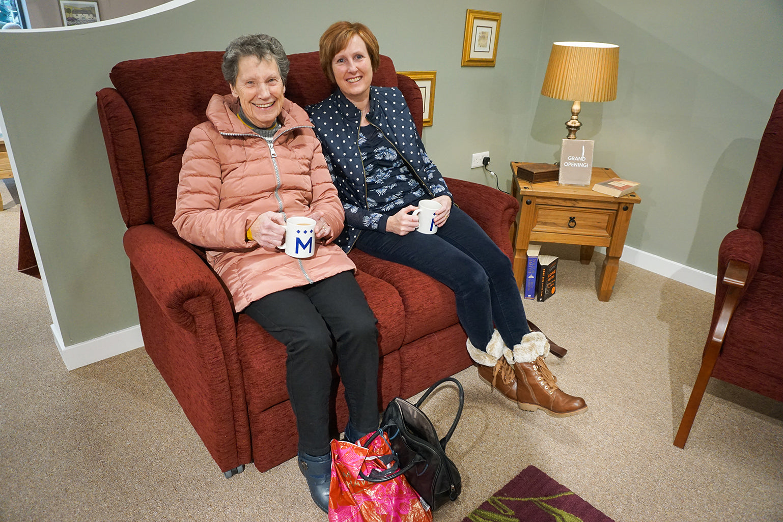Customers enjoy a cup of tea on a Middletons sofa