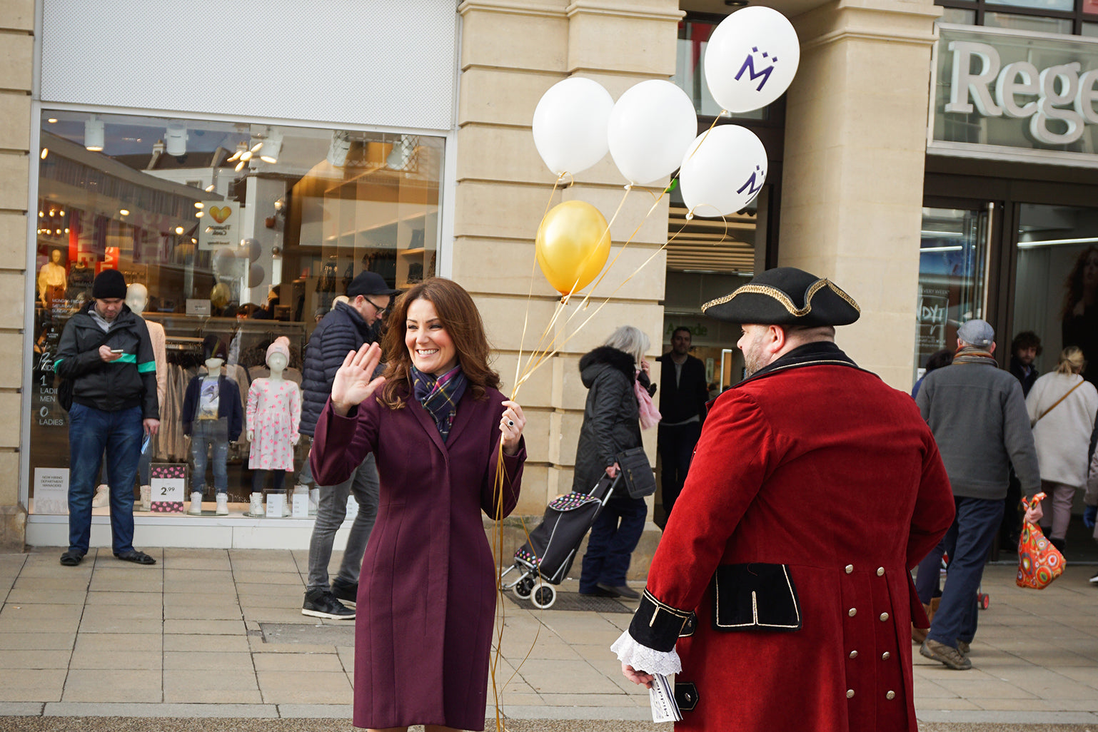 Kate Middleton lookalike holding Middletons balloons in Cheltenham