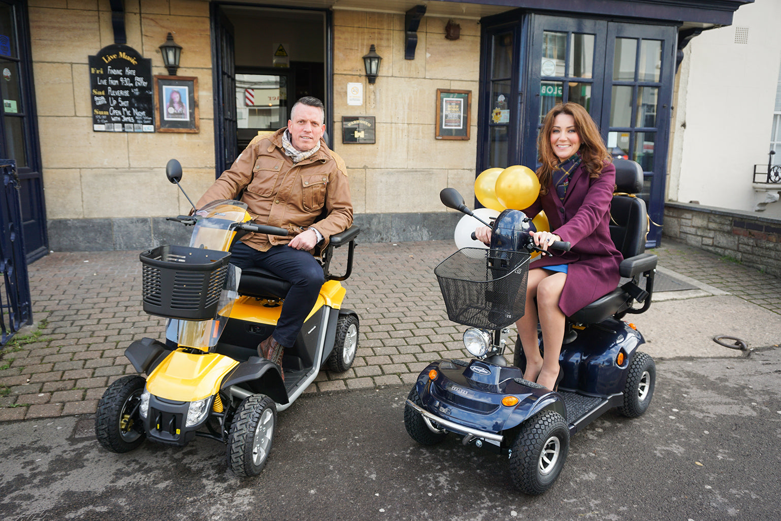 Middletons staff member and Kate Middleton sit on Middletons mobility scooters