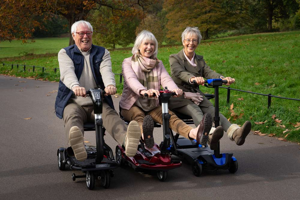 Elderly trio enjoying a day out on their mobility scooters