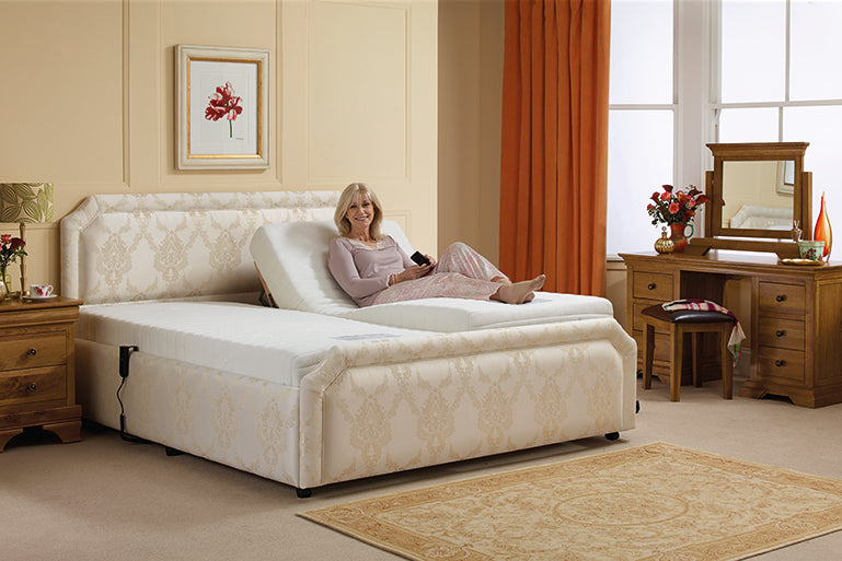 Woman lying on a Middletons adjustable bed