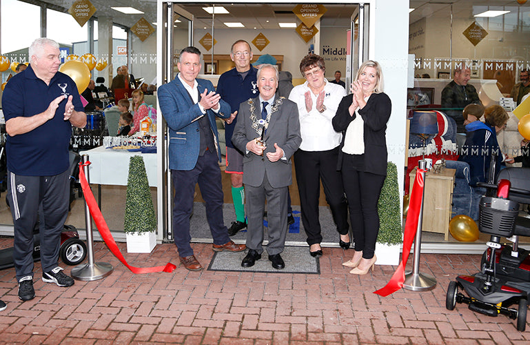 Image shows Mayor of Shrewsbury cutting a ribbon and opening the store