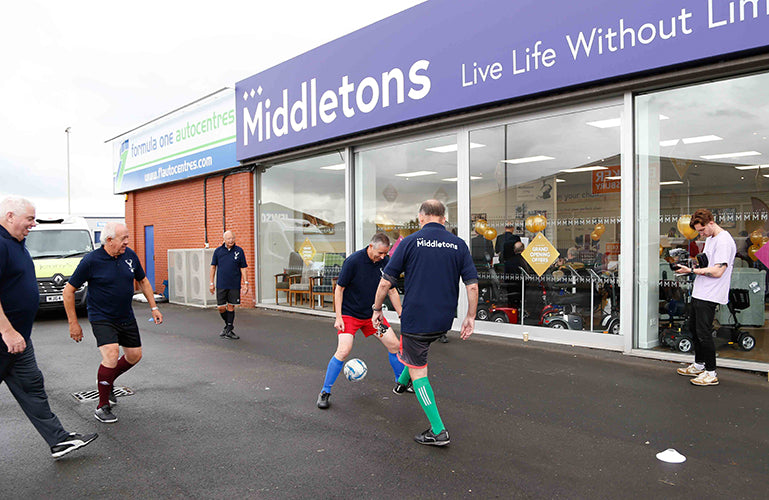 Image of men playing walking football wearing shirts with the Middletons logo