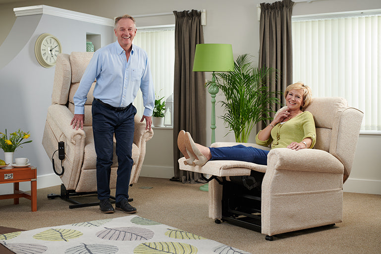 Couple relaxing in Middletons Windsor rise and recline chair with high leg lift motor