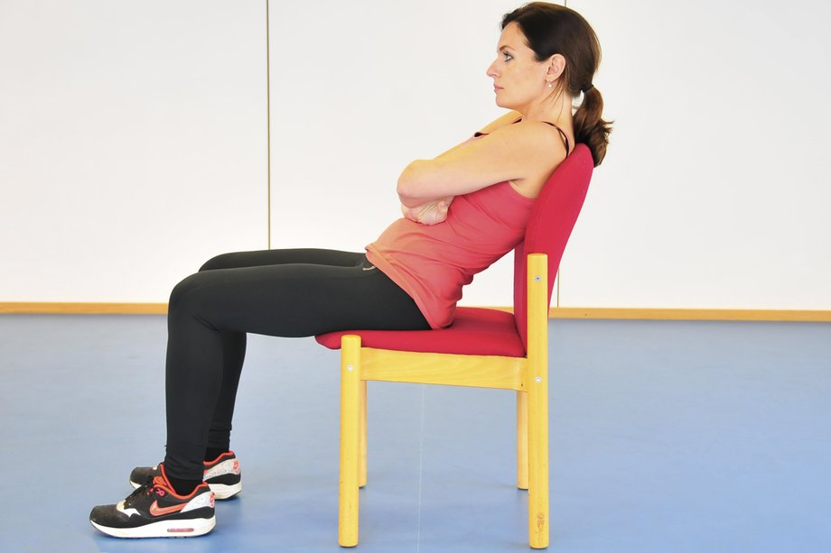 Picture of a woman with poor posture slouching in a chair