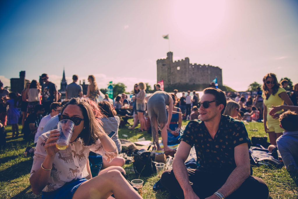 People enjoying the Tafwyl festival in Cardiff castle.