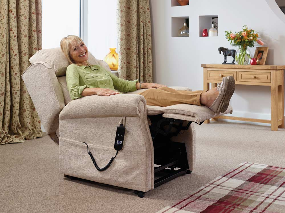 Woman relieving her swollen feet with a rise and recline chair.