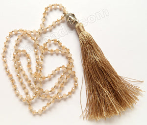 Long Chained Tassel Necklace w/ Silver Buddha Head Champ. Color