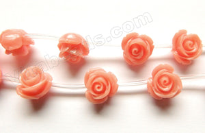 Synthetic Light Peach Coral Stone  -  Carved Rose Strand  7""