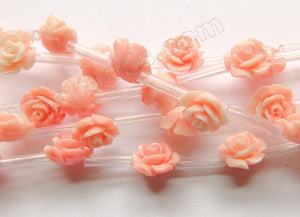 Synthetic Light Peach Coral Stone  -  Carved Rose Bulb Strand  15""
