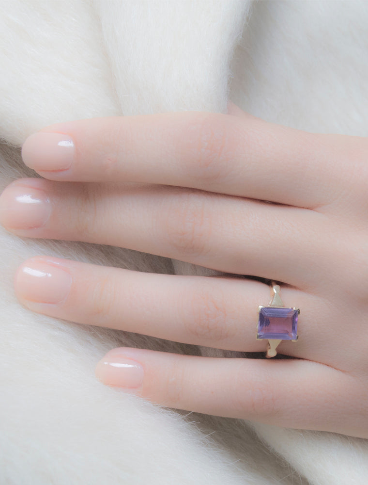 1930s Charon Amethyst Ring is a Baden and Foss of Boston created ring.  A beautiful rectangular cut amethyst with so much energetic warmth that weighs in at 2.6 carats and sits in a four prong set of 10k gold.  Stamped on the interior of the ring is 10K and B&F for Baden and Foss, one of our favorite vintage jewelers in the States. Ring size 6. Natural made. Not lab made.