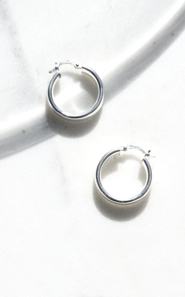 Taxco 925 Silver Earrings c. 1970s. 925 Taxco silver hoop earrings from Mexico with a clean, modernist feel. Original patina, earrings have never been polished.   Dimensions : .5 x .5 inches