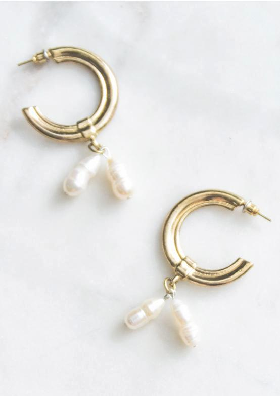 Baroque Pearl Earrings comprised of two freshwater pearls dangling from a gold molded hoop. Hypoallergenic push backing for pierced ears.