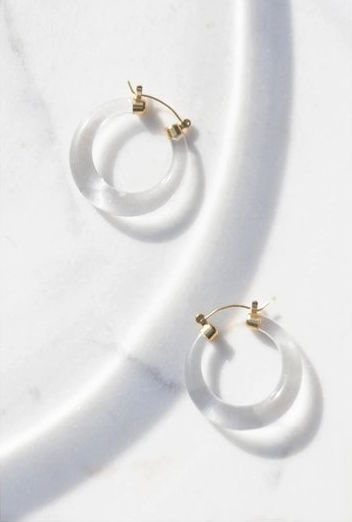 14k Gold Clear Lucite Hoop Earrings from our Recollect Collection for 2018. 14k gold push backing encased a curved sculptural hoop of clear lucite.  Dimensions: 1.25 x .40 inches
