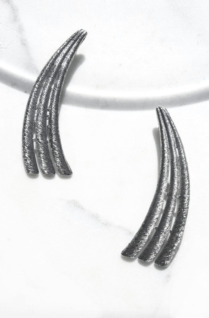 The Mira Oversized Earrings. Celestial inspired shape reminiscent of the tail of a shooting star. Named after the first shooting star recently found by NASA.  These oversized estate earrings from the 80s in silvertone. Push backing for pierced ears. Lightweight.   Only one available.  Dimensions: 3.5 x 2 inches
