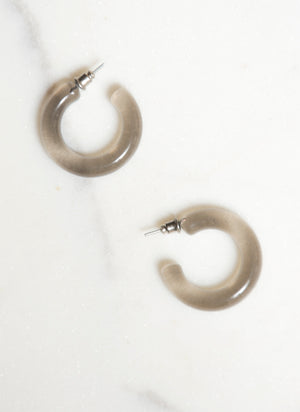 Smoke Out Lucite Hoop Earrings c. 1980s. Thick clear translucent smoke lucite earrings perfect for a spin on the everyday hoop.   Diameter : 1""