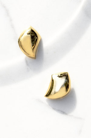 Modernist gold metal play on the shell with hypoallergenic push backing for pierced ears.