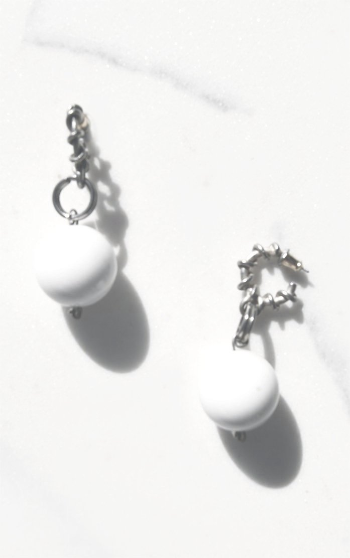 White Spiral Hoop Earrings c. late 1970s. Silvertone hoop earrings with a coil wrapped around that dangle a large white glass sphere. Push back.   Dimensions : 2 x 1 inches