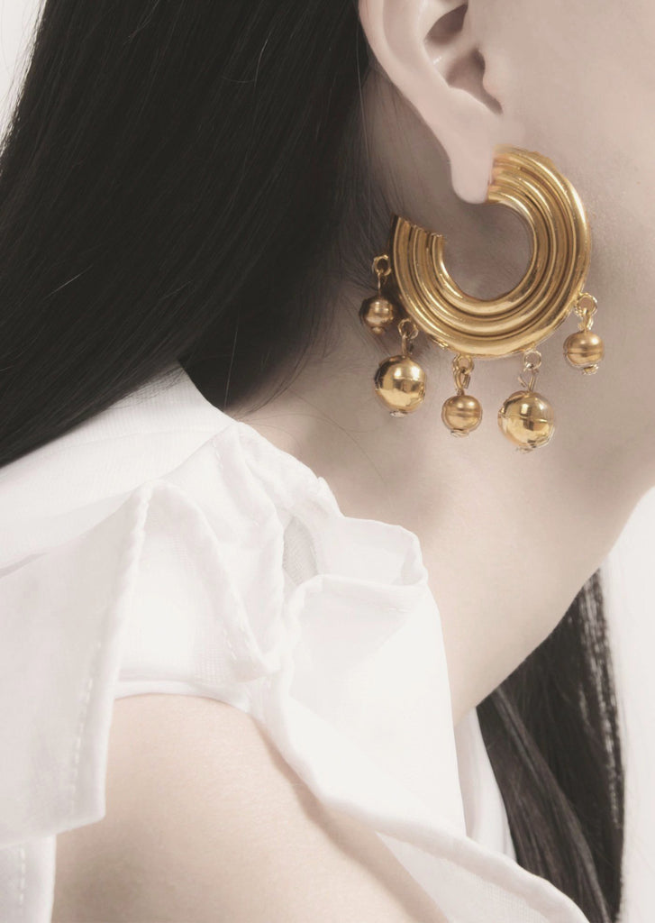 Estate oversized gold hoop earrings from the early 80s with hypoallergenic push backing for pierced ears.