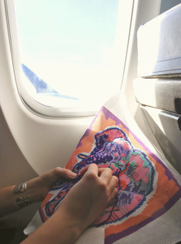 Brooke Stitching Eleanor The Elephant while Traveling. Thorn Alexander