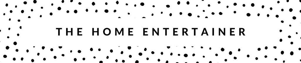 "polka dot banner with the words ""the home entertainer"" written across"
