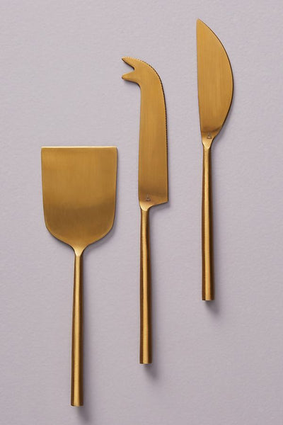 gold brass colored cheese knives set