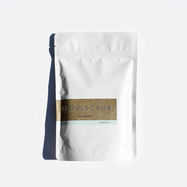 Peppermint coffee body scrub in a white bag with a brown label