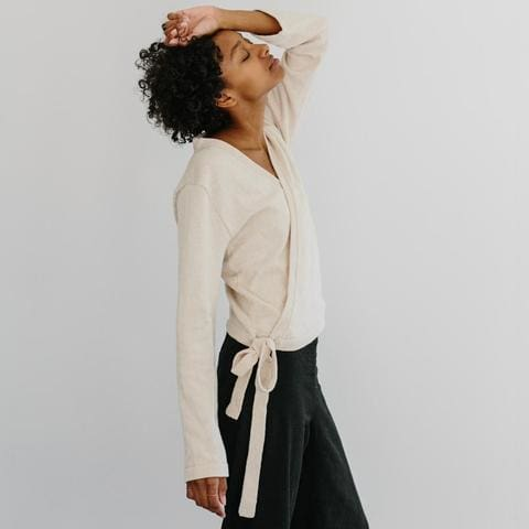 Ivory knit cotton long sleeve sweater top with side tie
