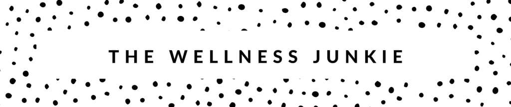 "polka dot banner with the words ""the wellness junkie"" written across"