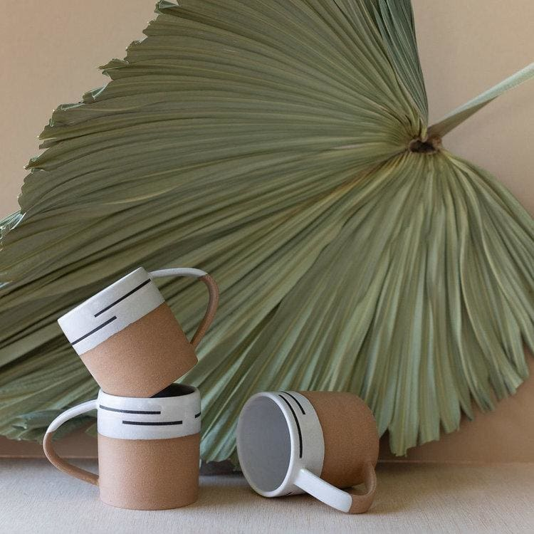 minimalistic white and tan mug set
