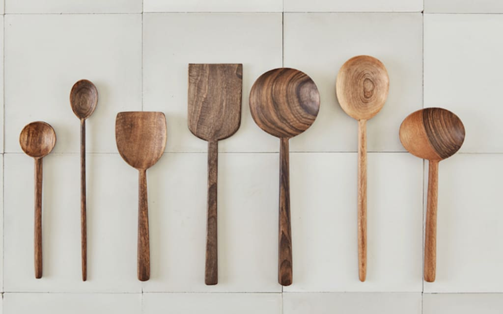 brown walnut spoons and cooking utensils