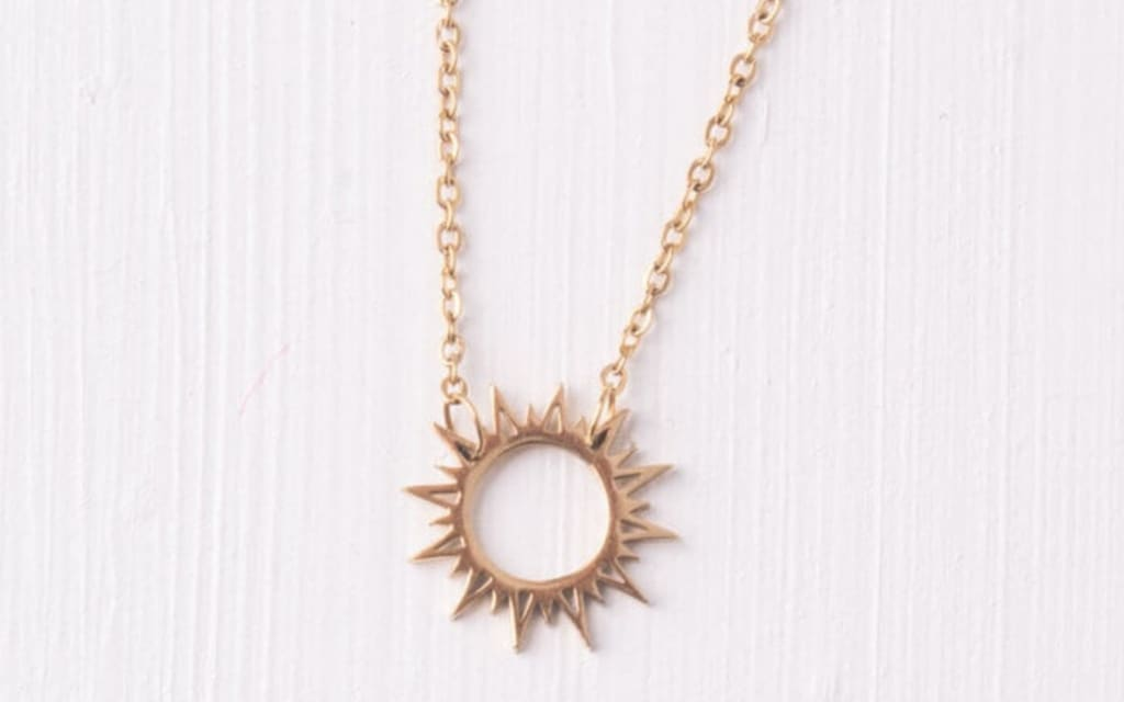 gold sunburst pendant necklace with chain