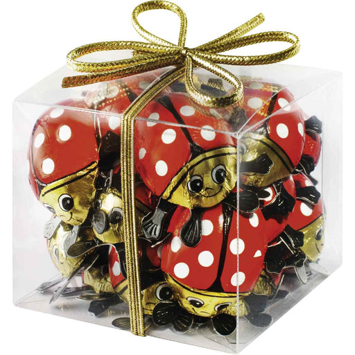 Riegelein Solid Ladybugs in Gift Cube - 10 Pieces are made with the finest premium 33% milk chocolate, foil wrapped, and packaged in an acetate cube with gold ribbon.