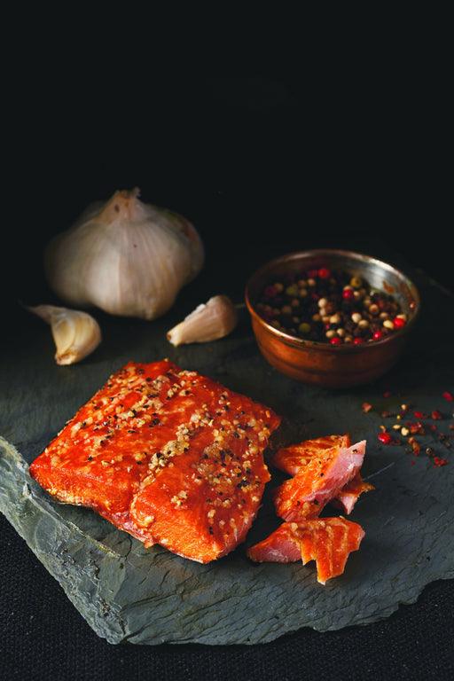 SeaBear Garlic Lover's Smoked Salmon has garlic in the brine, a light brushing of garlic olive oil, and minced garlic (along with cracked black pepper) on top, making this every garlic lover's dream come true.